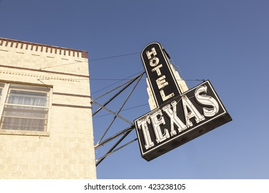 FORT WORTH, USA - APR 6, 2016: Hotel Texas sign in the Fort Worth Stockyards historic district. Texas, United States