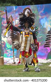 Fort York, Toronto - July 25, 2015 - Native American performers dancing at a pow-wow dressed in their traditional costumes representing their tribes.