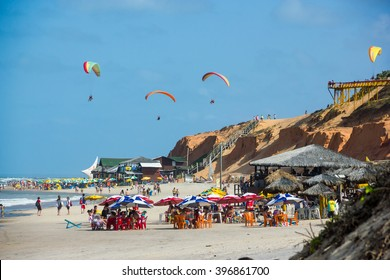 FORTALEZA, BRAZIL - JANUARY 2014: Canoa Quebrada Beach with a lot of people and paraglider, Fortaleza, Ceara, Brazil