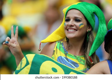 FORTALEZA, BRAZIL - June 17, 2014: Brazilian fans celebrating during the World Cup Group A game between Brazil and Mexico at Estadio Castelao. No Use in Brazil.