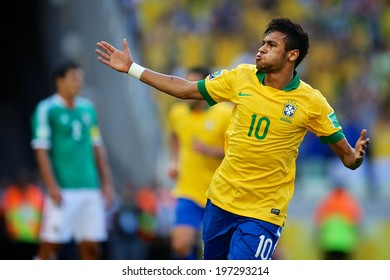 FORTALEZA, BRAZIL - June 19, 2013: Brazil's forward Neymar celebrates after scoring a goal against Mexico during the Confederations Cup soccer match at Arena Castelao. No Use In Brazil.