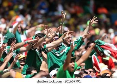 FORTALEZA, BRAZIL - JUNE 29, 2014: Fans of Mexico during the World Cup Round of 16 game between the Netherlands and Mexico in the Castelao stadium.  NO USE IN BRAZIL.