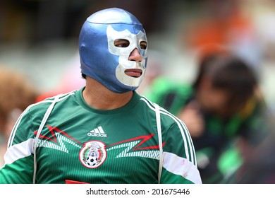 FORTALEZA, BRAZIL - JUNE 29, 2014: A soccer fan of Mexico celebrate during the World Cup Round of 16 game between the Netherlands and Mexico in the Castelao stadium. NO USE IN BRAZIL.