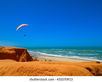 FORTALEZA, BRAZIL - OCTOBER 12, 2015: Unidentified people and paragliders at the Canoa Quebrada Beach. It was a Swiss pilot who introduced this new practice: Gerome Bertand Saunier, known as Jeronimo