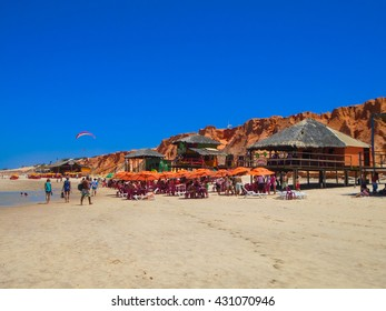 FORTALEZA, BRAZIL - OCTOBER 12, 2015: Unidentified people and paragliders at the Canoa Quebrada Beach. It was Swiss pilot who introduced this practice: Gerome Bertand Saunier, best known as Jeronimo