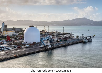 Fort-de-France, Martinique - December 19, 2016: Tanks and port infrastructure in the harbour of Martinique, Caribbean, Lesser Antilles. Martinique is an insular region of France.