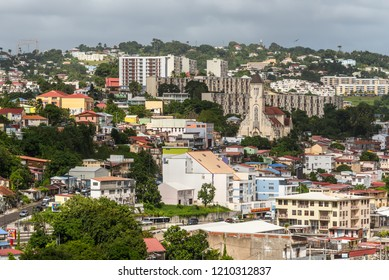 Fort-de-France, Martinique - December 19, 2016: Cityscape in cloudy weather and sunshine rays of Fort-de-France, Martinique, Lesser Antilles, West Indies, Caribbean. View from the cruise ship.