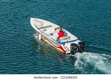 Fort-de-France, Martinique - December 19, 2016: Speedboat sails in harbour of Fort-de-France, Martinique, Caribbean. Martinique is an insular region of France.