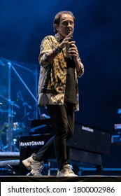 FORTE DEI MARMI, ITALY - AUGUST 17, 2020:  Roby Facchinetti performs singing on the stage of Villa Bertelli in Forte dei Marmi with his band.