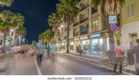 FORTE DEI MARMI, ITALY - JUNE 20, 2015: Tourists visit the city center at night. Forte di Marmi is one of the major touristic town along Tyrrhenian Sea.