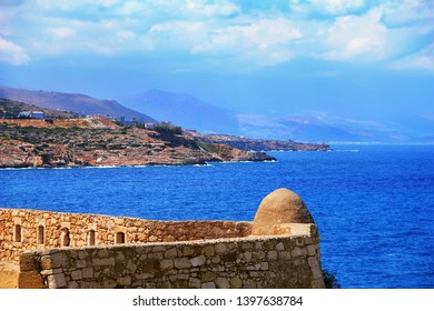 Fortezza of Rethymno (Rethimno Fortress), Crete island, Southern Greece, Europe. Beautiful view from the wall of ancient Venetian fort, bright blue water of Mediterranean sea and distant high coast