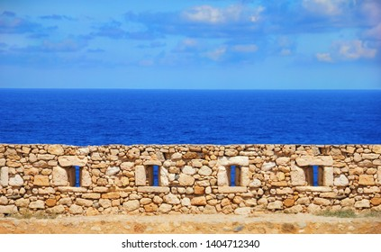 Fortezza of Rethymno (Rethimno Fortress), Crete island, Southern Greece, Europe. The wall of ancient Venetian fort, bright blue water of Mediterranean sea and sky