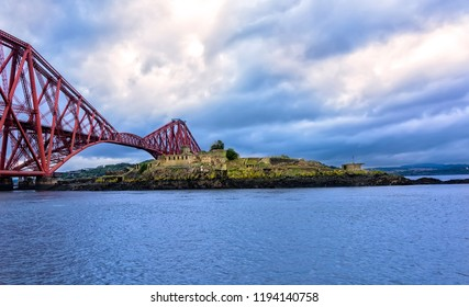 The Forth Bridge is a cantilever railway bridge across the Firth of Forth and passes over a small uninhabited island called Inchgarvie.