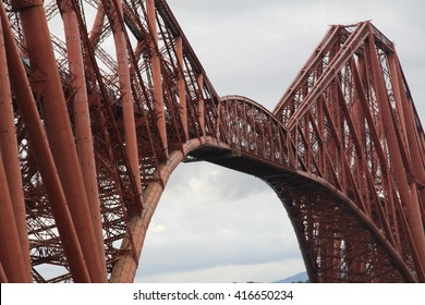 Forth Bridge in Edinburgh Scotland with refelction in the water. Suspension bridge for trains. UNESCO world heritage site. Firth of Forth.