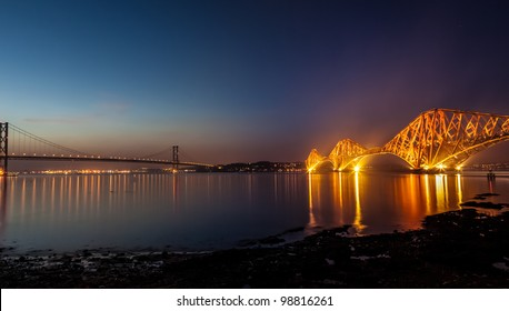 Forth Bridges, Scotland. The Rail Bridge, 1890 (floodlit), cantilever steel bridge, girder spans of 521m. The Road Bridge, 1964 with approaches is over 2km. Central span is over 1 km.