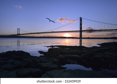 The Forth Road Bridge across the Firth of Forth near Edinburgh in Scotland in the United Kingdom. Viewed from Queensferry at sunset