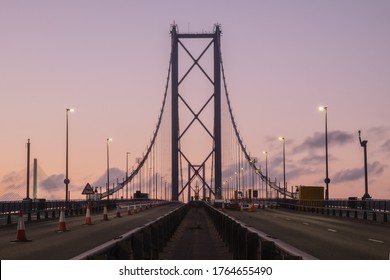 Forth Road Bridge closed for repairs in the evening against the sunset sky. United Kingdom