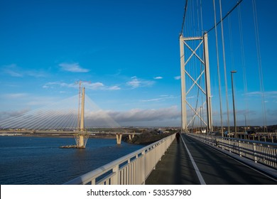 The Forth Road Bridge (on the right) and the new - still under construction - Queensferry Crossing (on the right) spanning over the Firth of Forth. Near Edinburgh, Scotland, UK