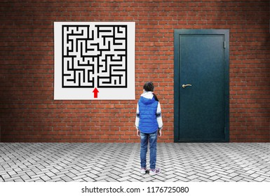 Forthcoming difficulties. A little girl is standing in front of the labyrinth plan and a closed door