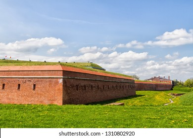 """Fortification Walls of the Old town in Zamosc, Poland. Zamosc - example of a Renaissance town in Central Europe, designed with Italian theories of """"ideal town"""", UNESCO World Heritage List."""