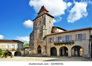 Fortified church and city Hall building in Royal square of Labastide d Armagnac, in the center of ancient bastide in Aquitaine, France