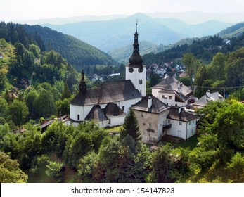 Fortified Church of the Transfiguration in village of Spania Dolina surrounded by the Stare Hory and Velka Fatra mountains in central Slovakia. Spania Dolina is historical mining village.
