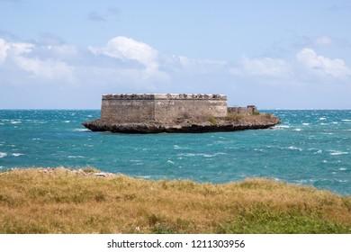 Fortim de São Lourenço da Ilha de Moçambique. Sao Lourenco Blockhouse. San Lorenzo Island and fort nearby grassy shore and coastline of Mozambique island, Indian ocean coast. Portuguese East Africa