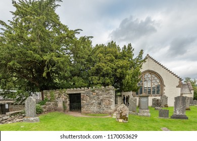 FORTINGALL, SCOTLAND - august 27, 2018: The famous yew tree in the churchyard of the village of Fortingall in highland Perthshire.  The tree is thought to be around 3,000 to 5,000 years old.