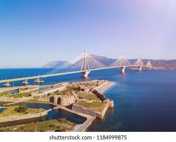 Fortress and bridge of Rio Antirio, Patra, Peloponnese, Greece. Aerial drone bird's eye view photo. Panorama