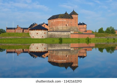 The fortress of the city of Hameenlinna with a reflection on a sunny July morning. Finland