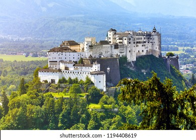 Fortress Salzburg in Austria medieval castle at cliff under the old town. Famous landmark with summer sky with clouds.