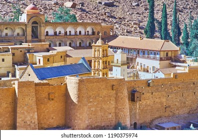 The fortress of St Catherine Monastery with preserved huge stone walls and historical churches, crypts and mosque, Sinai desert, Egypt.