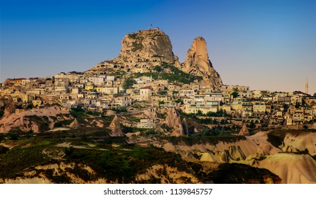 The fortress Urchisar Castle in Cappadocia located on the highest point in the region. Houses are built into the hillside. A major attraction the citadel is the largest and tallest fairy chimney.