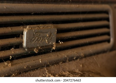 Fortuna Missouri - November 30 2019: The Ford decal on a grate in a vintage truck in a rural farm shed.