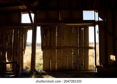Fortuna Missouri - November 30 2019: Crumbling walls in a wood farm shed.