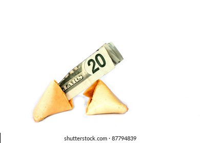 Fortune cookie broken in half with cash sticking out.