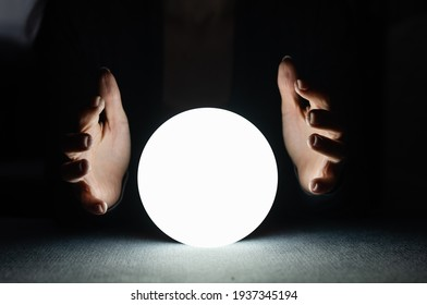 A fortune teller gazes into her ball