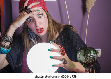 Fortune teller shocked with what she sees in her crystal ball