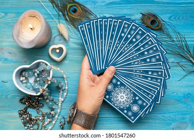 Fortune teller with a tarot cards in hands.