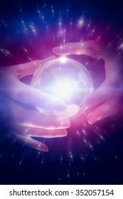 Fortune teller using crystal ball against twinkling stars
