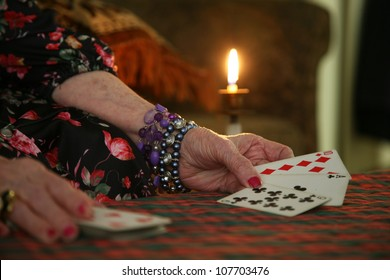 fortune teller's cards with candle light in back