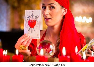 Fortuneteller with Tarot cards or esoteric Oracle, sees in the future