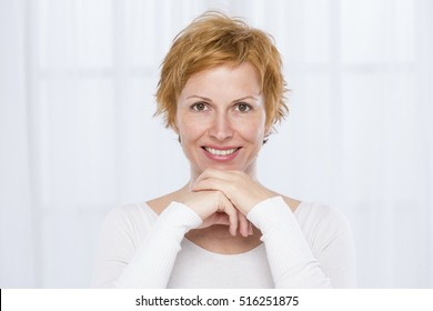 Forty years old woman with short hair