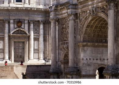 Forum romanum of Ancient rome Arch of Septimius Severus (Arcus Severi) with two unrecognizable romans dressed like ancient legionary.