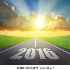 Forward to 2016 new year concept , asphalt road with arrow , date and beautiful sunset and sunshine