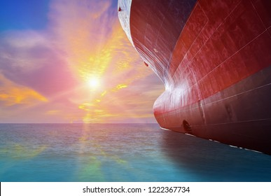 Forward of Ship Low angle view nose ship, Bulbous bow ship under blue sky background, up risen angle under ship repair in floating dry dock in shipyard isolated on white background.
