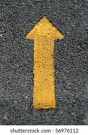 A forwarded yellow arrow on the road
