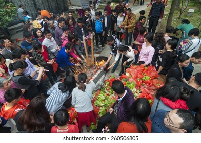 FOSHAN  Feb 27:Ninth day of the Chinese New Year, people worship offering a stone, the legend that sit on the stone can let want to pregnant women with children Feb 27, 2015 in Foshan, China