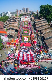 Foshan,China-October 1, 2018:To celebrate the National Day holiday, dozens of women wearing qipao and carrying umbrellas showed off the traditional Chinese culture to tourists at the ceramic ancient.