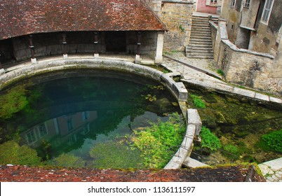 The Fosse Dionne is the source of the Vaucluse spring and is dedicated to the ancient Goddess Divona. . . which means divine. A circular wash basin and tile  gallery was added in the 18th century.